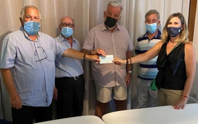 Othello Lodge presents a cheque Multiple Sclerosis Society